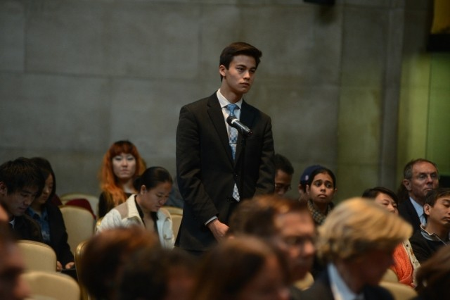 Columbia University student's line up to ask a question during the question and answer session.