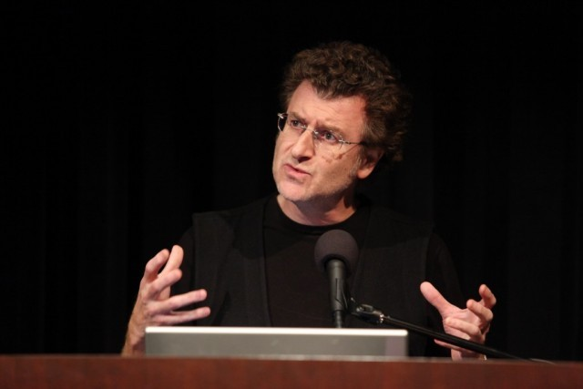 Artist, Alfredo Jaar, presents to the audience in Miller Theatre on October 1, 2009.