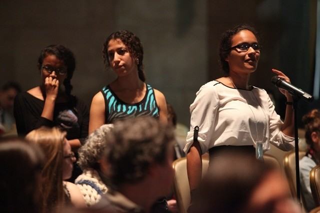 Columbia University students line up to ask a question during the question and answer session.